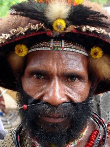 A Huli Wigman approaches to discuss at a market outside Tari, Southern Highlands in Papua New Guinea. Click to enlarge.