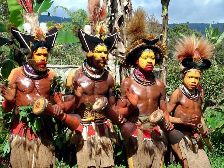 Huli Wigman in Tari, Southern Highlands in Papua New Guinea are dancing and singing a ceremonial singsing for us. Click for a bigger picture.